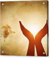Raised Hands Catching Sun On Sunset Sky. Concept Of Spirituality, Wellbeing, Positive Energy Acrylic Print