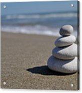 Stack Of Pebbles On Beach Acrylic Print