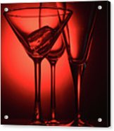 Three Empty Cocktail Glasses On Red Background Acrylic Print