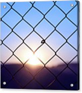 Wire Mesh Fence On A Sunset Background Acrylic Print