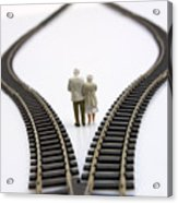 Figurines Between Two Tracks Leading Into Different Directions Symbolic Image For Making Decisions. Acrylic Print