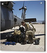 Pararescuemen Sorts Out His Gear Acrylic Print