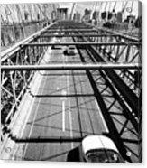 traffic vehicles driving over the worn tarmac on brooklyn bridge New York City USA Acrylic Print