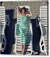 Girl Lies On A Chaise Longue In A Green Striped Dress Acrylic Print