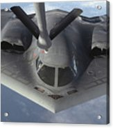 A B-2 Spirit Bomber Prepares To Refuel Acrylic Print by Stocktrek Images