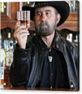 A Bearded Cowboy In Black Contemplates His Whiskey In A Saloon Acrylic Print