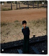 A Boy In Burma Looks Towards A Train From The Shadows Acrylic Print