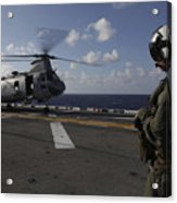 A Crew Chief Watches A Ch-46e Sea Acrylic Print