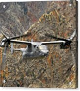 A Cv-22 Osprey Flies Over The Canyons Acrylic Print
