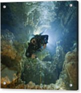 A Diver Ascends A Deep Shaft In Dans Acrylic Print by Wes C. Skiles