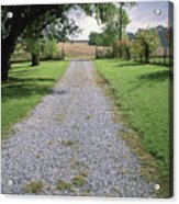 A Gravel Road Marks The Entranceexit Acrylic Print