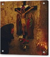 A Greek Pilgrim Prays In The Grotto Acrylic Print by Annie Griffiths