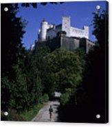 A Man Walks Toward The Salzburg Castle Acrylic Print by Taylor S. Kennedy