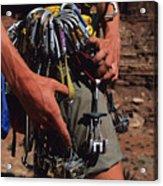 A Rock Climber Check Her Gear Acrylic Print by Bill Hatcher