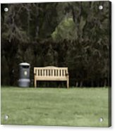A Trash Can And Wooden Benches In A Small Grassy Area Acrylic Print