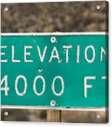 A Weathered Elevation Sign On Highway Acrylic Print