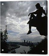 A Woman Perched On An Overlook Acrylic Print by Lynn Johnson