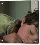 A Young Boy Sleeps In Green Pajamas Acrylic Print