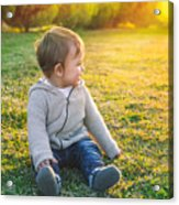 Adorable Baby Playing Outdoors Acrylic Print