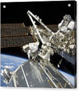 Astronauts Perform A Series Of Tasks Acrylic Print by Stocktrek Images