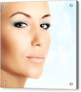 Beautiful Female Face Over Abstract Blue Sky Background Acrylic Print