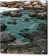 Black Rocks On Blue Water Acrylic Print