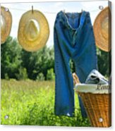Blue Jeans And Straw Hats On Clothesline Acrylic Print