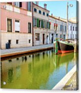 boat in a canal of the colorful italian village of Comacchio in  Acrylic Print