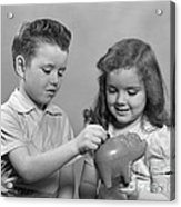 Boy And Girl Putting Money Into Piggy Acrylic Print