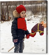 Boy On A Toy Horse Is Standing On The Street In Winter Acrylic Print