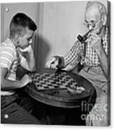 Boy Playing Checkers With Grandfather Acrylic Print