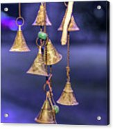 Brass Bells Hanging In The Illuminated Courtyard At Winter Night Acrylic Print