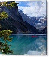 Canoe On Lake Louise Acrylic Print by Larry Ricker