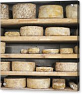 Cheese Wheels On Wooden Shelves In The Cheese Store Acrylic Print