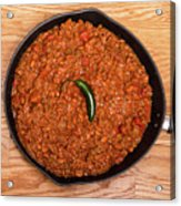 Chili In Black Pan On Wood Table With Jalapeno Pepper Acrylic Print