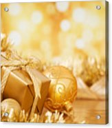 Christmas Scene With Gold Baubles And Gift On A Gold Background Acrylic Print
