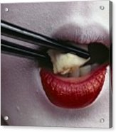 Close View Of A Geisha Eating Tofu Acrylic Print by Chris Johns