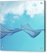 Cloth In The Wind Against The Blue Cloudy Sky. Acrylic Print