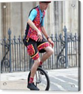 Clown Riding Unicycle In Town Acrylic Print