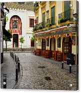 Cobblestone Argote De Molina Street With Cafe Ending At The Nort Acrylic Print