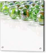 Composition With Green Marbles On White Background Acrylic Print