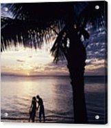 Couple Silhouetted On Beach Acrylic Print