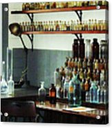 Desk With Bottles Of Chemicals Acrylic Print