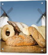 Different Breads And Windmill In The Background Acrylic Print by Deyan Georgiev