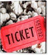 Event Ticket Lying On Pile Of Popcorn Acrylic Print