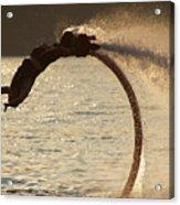 Flyboarder Doing Back Flip Over Backlit Waves Acrylic Print