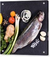 Fresh Whole Raw Fish And Herbs Displayed On Natural Slate Stone  Acrylic Print