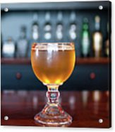 Goblet Of Refreshing Golden Beer On Shiny Dining Table Acrylic Print