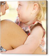 Happy Mother Holding Baby With Look Of Surprise Acrylic Print
