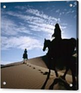 Horseback Riders In Silhouette On Sand Acrylic Print